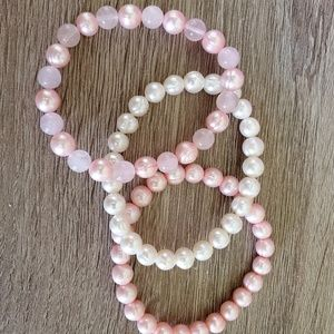 Pink and white pearl stacking bracelets